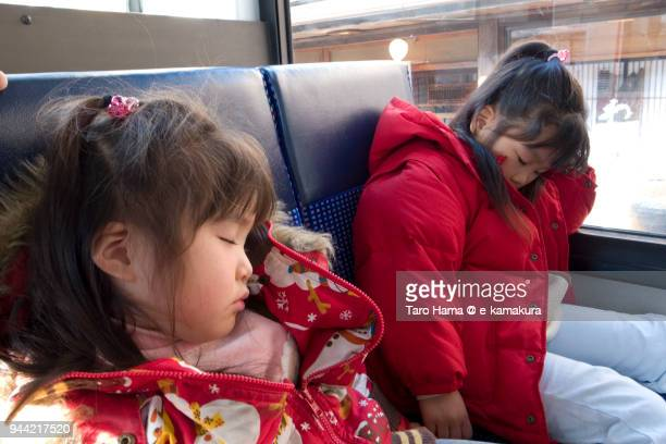 The girls sleeping in the bus in Japan