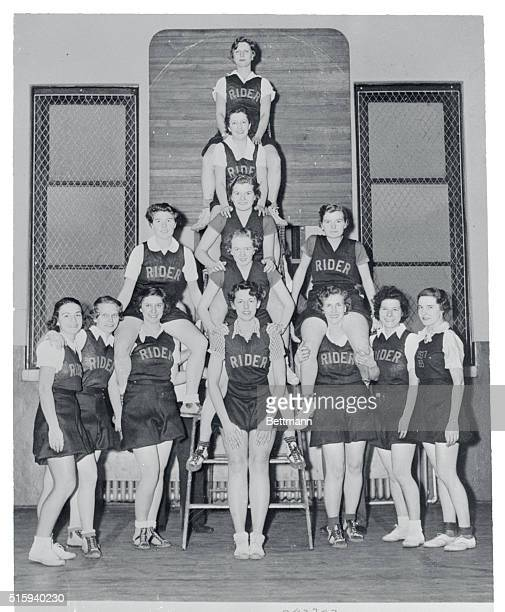 The Girl's Varsity Basketball Squad of Rider College at Trenton New Jersey is shown as they posed in the college gym Left to right in the front row...