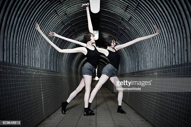 The girls with long arms dancing in the tunnel