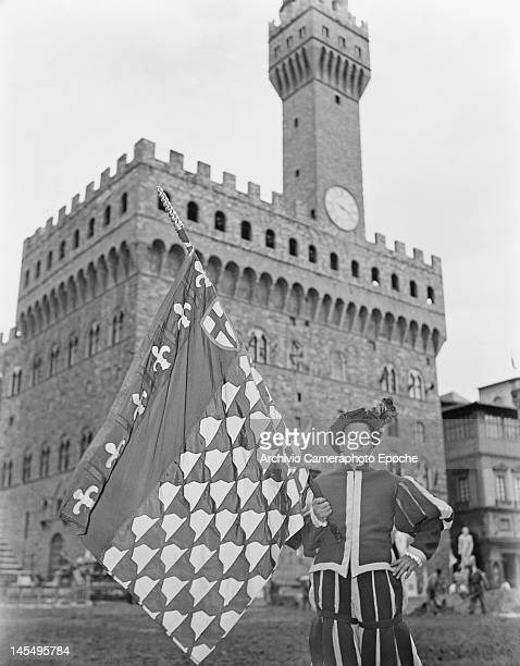 The Giuoco del Calcio Fiorentino an early form of football still played in Florence Italy circa 1955 In the background is the Palazzo Vecchio the...