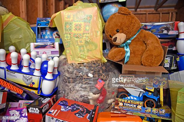 The Glad to Give program suprises local hero Charles WIlliams and family with a semitruck sized donation of toys to 'Chucky's Mission' which collects...