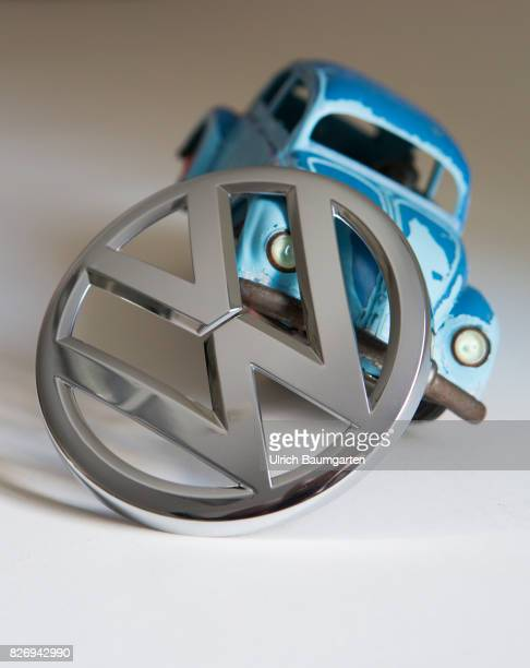The glamor is gone The Volkswagen Group in the swirl of the exhaust gas scandal The symbol photo shows a VW Beetle model in an oblique position with...