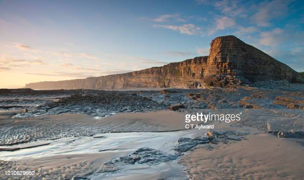 the glamorgan heritage coast at sunset - rock stock pictures, royalty-free photos & images