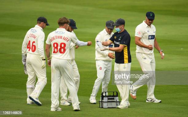 The Glamorgan side sanitize their hands during Day One of the Bob Willis Trophy match between Somerset and Glamorgan at The Cooper Associates County...