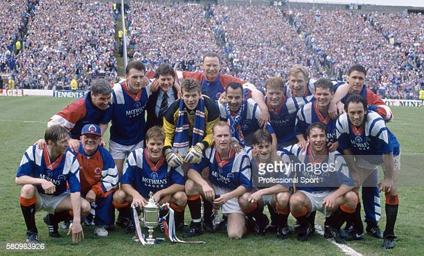 The Glasgow Rangers team celebrate after their victory in the Scottish FA Cup Final between Glasgow Rangers and Airdrieonians at Hampden Park in...
