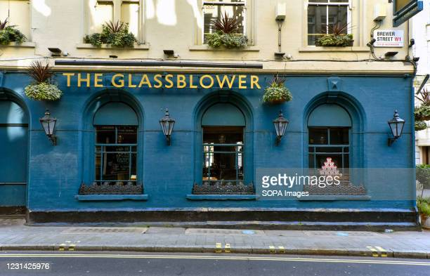 The Glass Blower pub in London, still with a sign on a window advertising bookings for Christmas as it remains closed during the third national...
