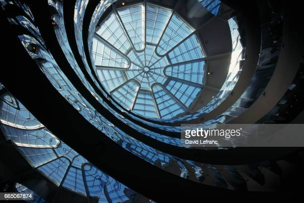 The glass dome of the coil spiral gallery permits natural light to play a predominant role in the Guggenheim Museum, designed by architect Frank...