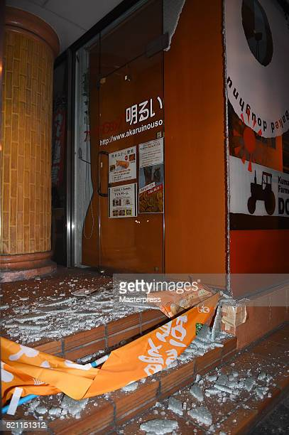 The glass door of a store is seen broken due to the earthquake on April 14 2016 in Kumamoto Japan A powerful earthquake with a preliminary magnitude...