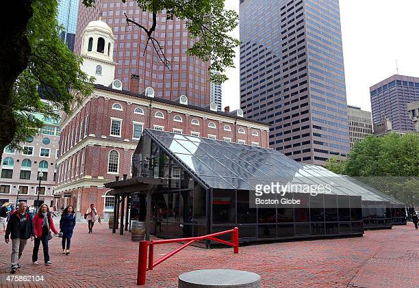 The glass enclosure that once housed a garden shop will be torn down and replaced at the Faneuil Hall Marketplace