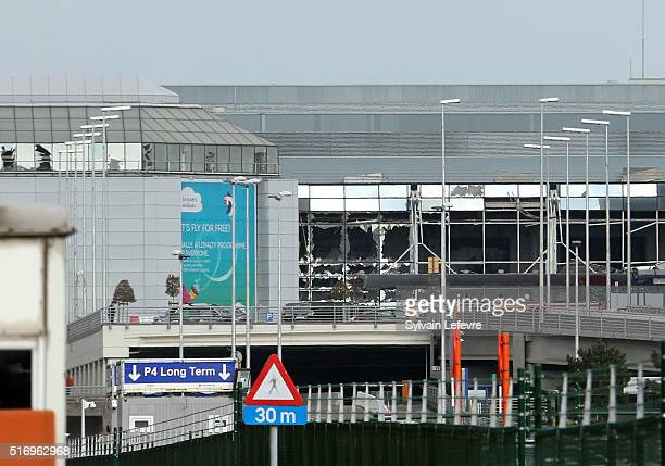 The glass front of the departure hall appears to be blown out after terrorist attacks at Zaventem Bruxelles International Airport on March 22 2016 in...