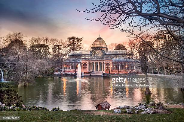CONTENT] The Glass Palace Retiro Park in Madrid Sunset color in the pondThe Palacio de Cristal is a glass and metal structure located in Madrid's...
