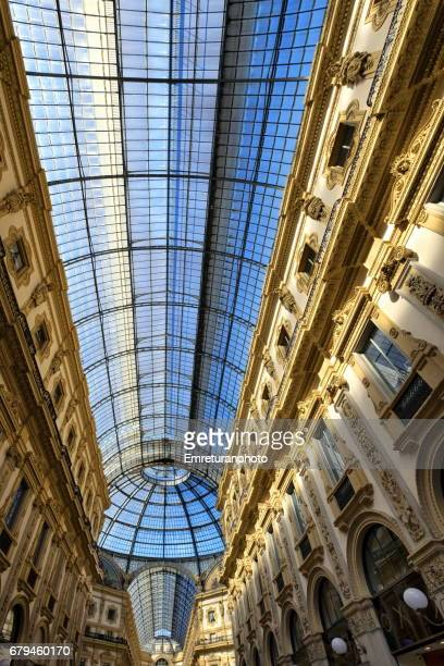 the glass vaulted archade of galleria vittorio emanuele 2,milan. - emreturanphoto stock pictures, royalty-free photos & images