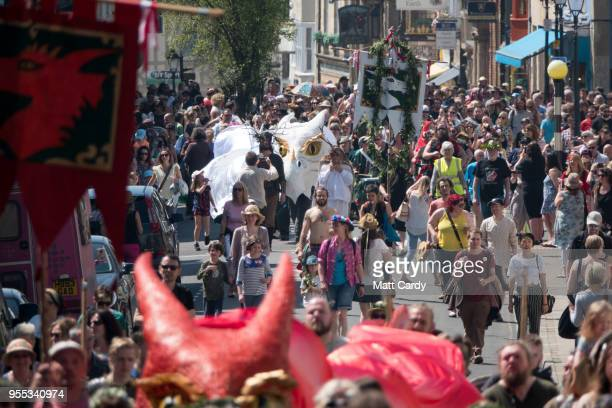 The Glastonbury Dragons are paraded through the town as they take part in May Fayre and Dragon Procession in Glastonbury on May 6 2018 in Somerset...