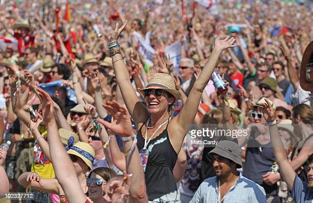The Glastonbury Festival crowd celebrate England's goal during their World Cup match that is being shown on the main stage screens at Worthy Farm,...