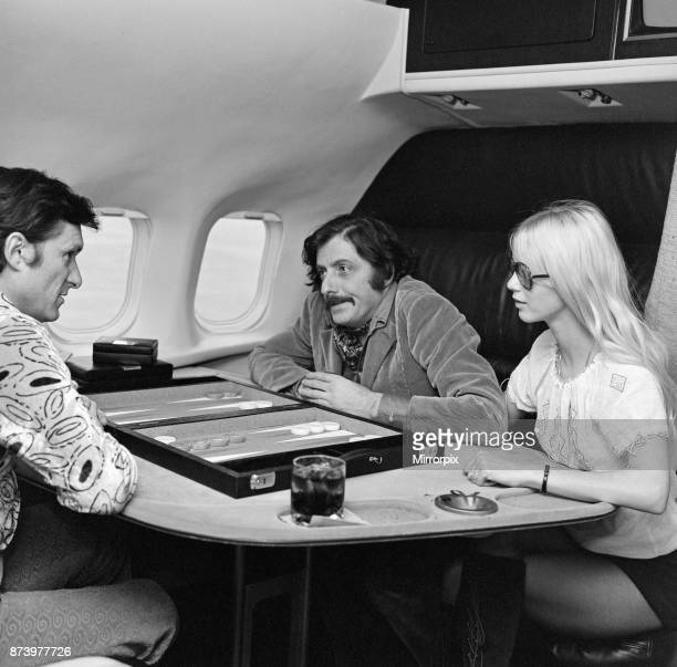 The gleaming black Playboy jet leaves London's Heathrow airport for Chicago Hugh Hefner pictured on board playing blackgammon 20th February 1971