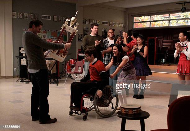 """The Glee club show Will (Matthew Morrison their winning trophy in """"Sectionals,"""" the fall finale episode of GLEE airing Wednesday, Dec. 9 on FOX...."""