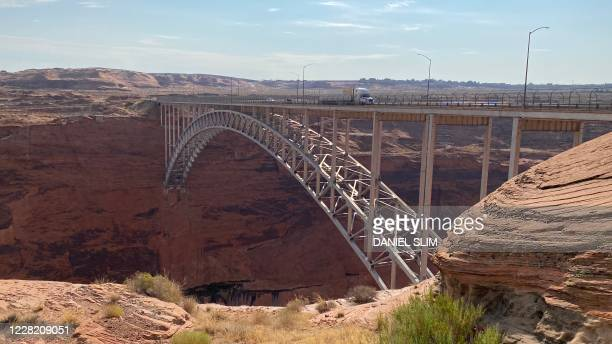 The Glen Canyon Dam Bridge is viewed near the town of Page Arizona on August 25 2020 Glen Canyon Dam is a 710foot high dam which forms Lake Powell...