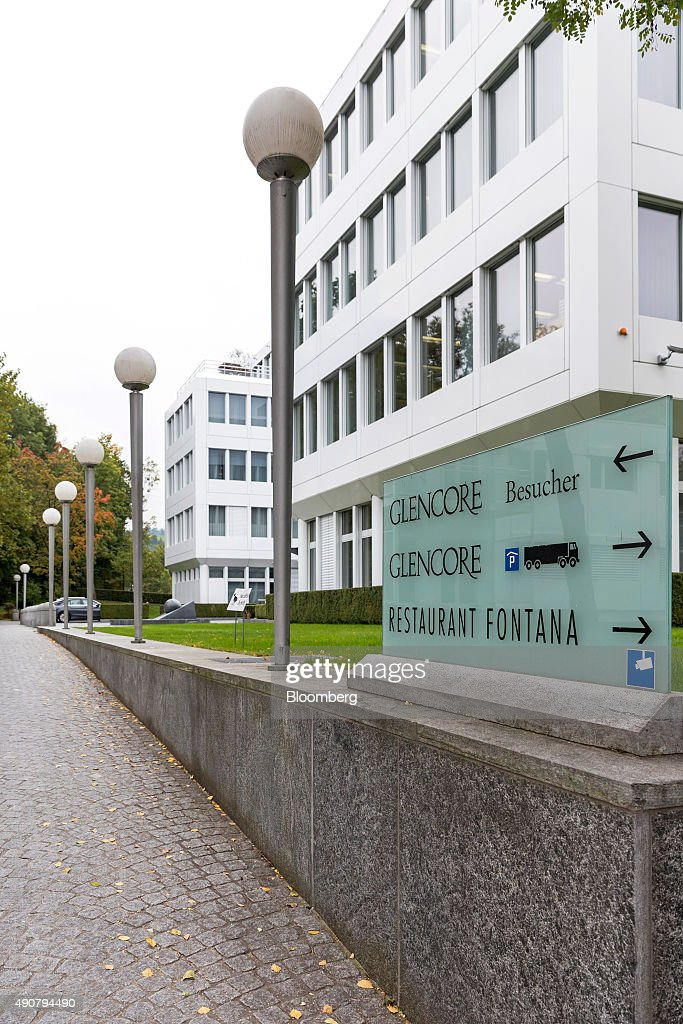 The Glencore company sign sits in the foreground against the backdrop of the Glencore Plc headquarters in Baar, Switzerland, on Wednesday, Sept. 30, 2015. Glencore Plc wiped out Monday's record slump as the shares rose for a third day alongside higher metals prices. Photographer: Alessandro Della Bella/Bloomberg via Getty Images