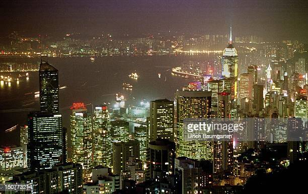 The glittering metropolis of Hongkong A view of the Peak the building mountain onto a fascinating panorama at night