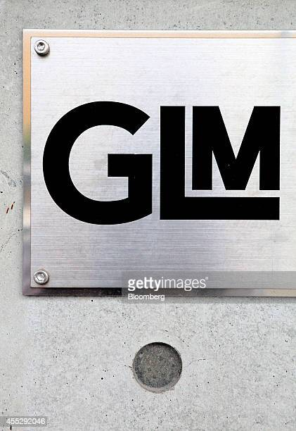 The GLM Co logo is displayed at the company's RD facility in Uji Kyoto Prefecture Japan on Tuesday Aug 12 2014 GLM is a Kyoto Japan based electric...