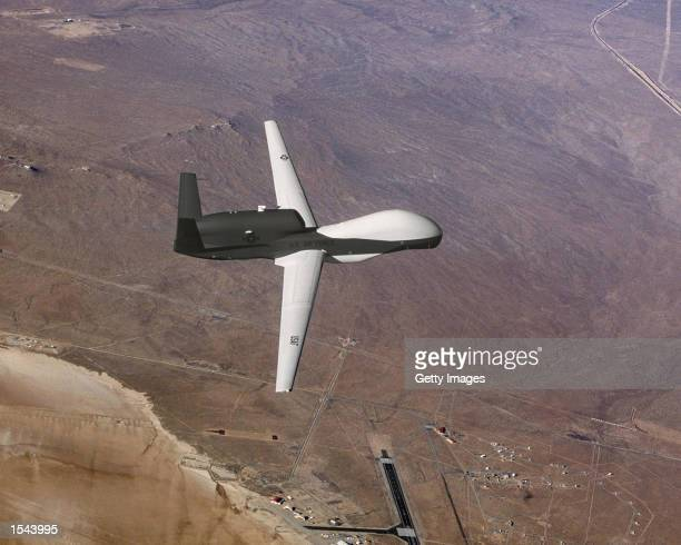 The Global Hawk unmanned aerial vehicle displays its new paint scheme in this undated photo The Hawk is a longendurance highaltitude unmanned aerial...