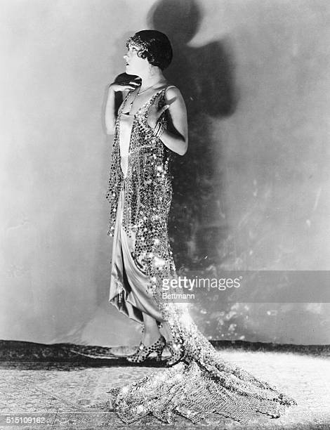 The Glorious Gloria in a Glorious Gown And now they are making dresses out of steel Miss Gloria Swanson proves it The plate from scrapped battleships...