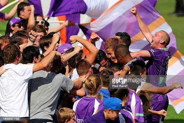 The Glory celebrate a goal by Jamie MacLaren with supporters during the round three ALeague match between Perth Glory and the Melbourne Heart at nib...