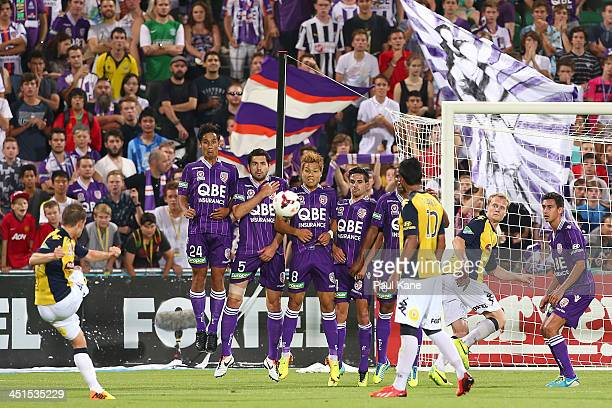 The Glory look to block a free kick on goal by Michael McGlinchey of the Mariners during the round seven ALeague match between Perth Glory and the...