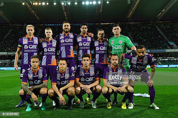 The Glory players line up for a team photo during the round one ALeague match between the Perth Glory and the Central Coast Mariners at nib Stadium...