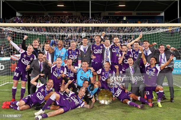 The Glory pose with the Premiers Plate after being crowned Premiers during the round 25 ALeague match between the Perth Glory and the Newcastle Jets...