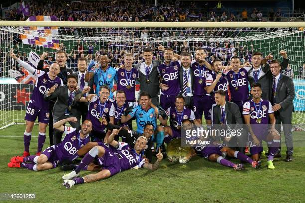 The Glory pose with the Premiers plate after winning the round 25 ALeague match between the Perth Glory and the Newcastle Jets at HBF Park on April...