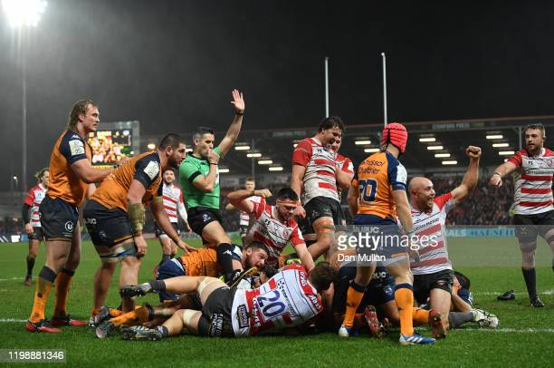 The Gloucester players celebrate as Referee Frank Murphy awards their fourth try scored by Todd Gleave of Gloucester during the Heineken Champions...