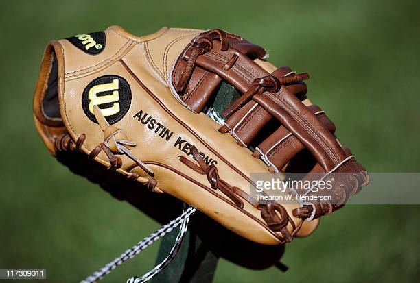 The glove of Austin Kearns of Cleveland Indian sits on a pole during batting practice before a MLB baseball game against the San Francisco Giants at...