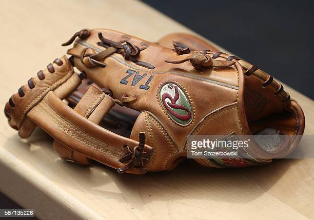 The glove of Troy Tulowitzki of the Toronto Blue Jays rests on the bench with the name of his son Taz embroidered into the leather before the start...