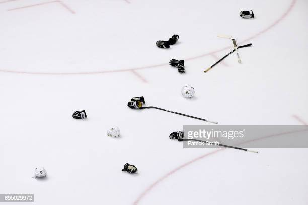 The gloves, helmets and sticks of the Pittsburgh Penguins are seen during their celebration after defeating the Nashville Predators 2-0 to win the...