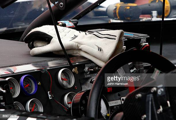 The gloves of Greg Biffle driver of the 3M Ford sit on his dashboard of his car during practice for the NASCAR Sprint Cup Series Goody's Fast Pain...