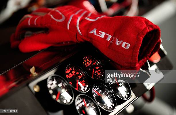 The gloves of Tony Stewart rest on the dashboard of the Old Spice Chevrolet in the garage during practice for the NASCAR Sprint Cup Series Heluva...
