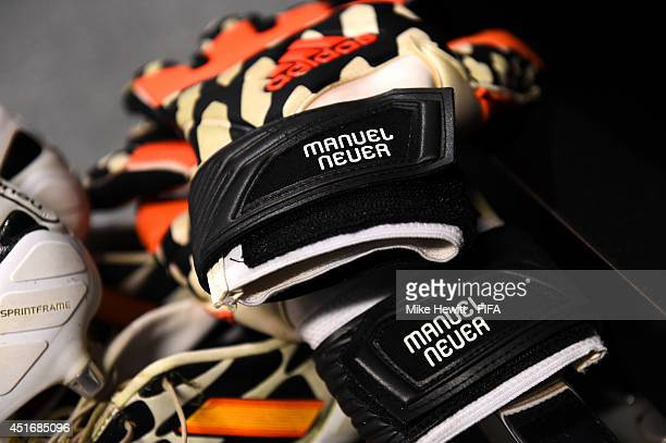The gloves worn by Manuel Neuer of Germany are pictured in the dressing room prior to the 2014 FIFA World Cup Brazil Quarter Final match between...