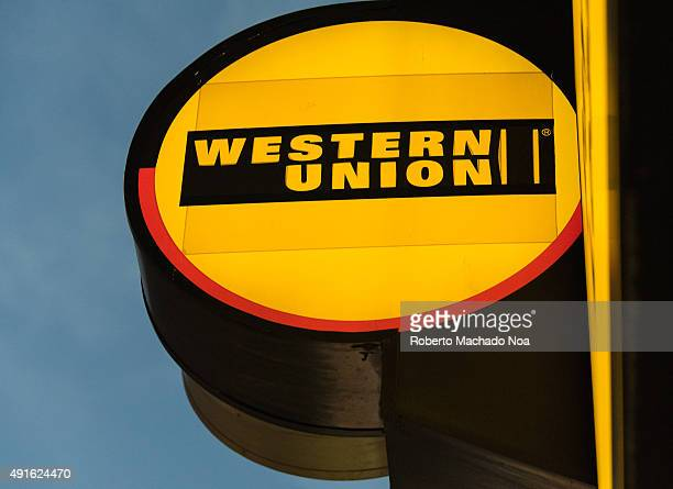 DOWNTOWN TORONTO ONTARIO CANADA The glowing signage of Western Union at its agent location in Toronto The Western Union Company is an American...
