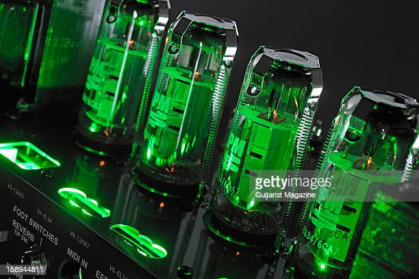 The glowing vacuum tubes inside a Carvin VL300 Legacy 3 electric guitar amplifier head unit photographed during a studio shoot for Guitarist Magazine...