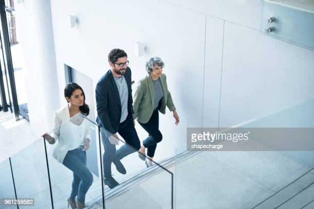 the go getters have entered the building - stairs stock photos and pictures