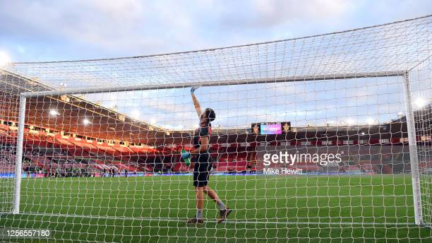 The goal is cleaned during the Premier League match between Southampton FC and Brighton & Hove Albion at St Mary's Stadium on July 16, 2020 in...
