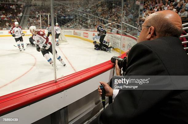 The goal judge takes up his new position as the Colorado Avalanche face the Los Angeles Kings during preseason NHL action at the Pepsi Center on...
