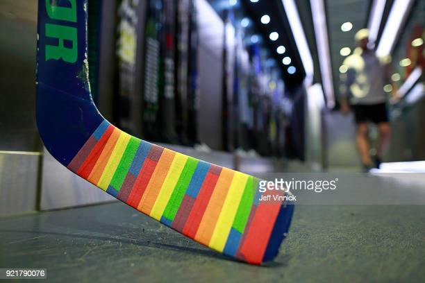 The goal stick of Anders Nilsson of the Vancouver Canucks is covered in Pride tape as it sits in the Canucks dressing room before their NHL game...