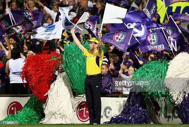 The goal umpire signals a goal as Dockers fans celebrate during the round 14 AFL match between the Fremantle Dockers and the Essendon Bombers at...