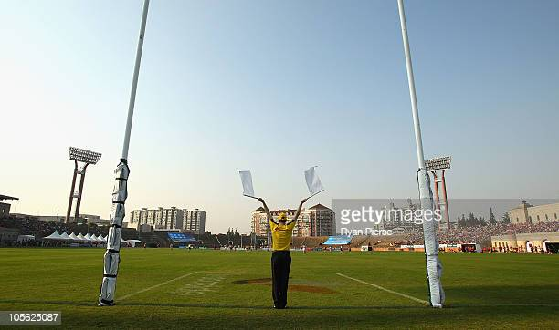 The goal umpire signals a goal during the AFL Kaspersky Cup Shanghai Showdown match between the Brisbane Lions and the Melbourne Demons at Jiangwan...