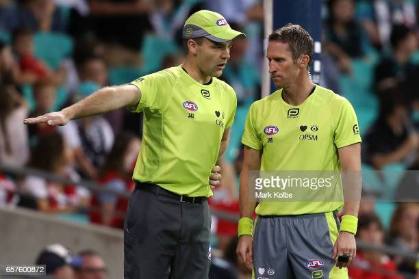 The goal umpire speaks to umpire Shaun Ryan during the round one AFL match between the Sydney Swans and the Port Adelaide Power at Sydney Cricket...
