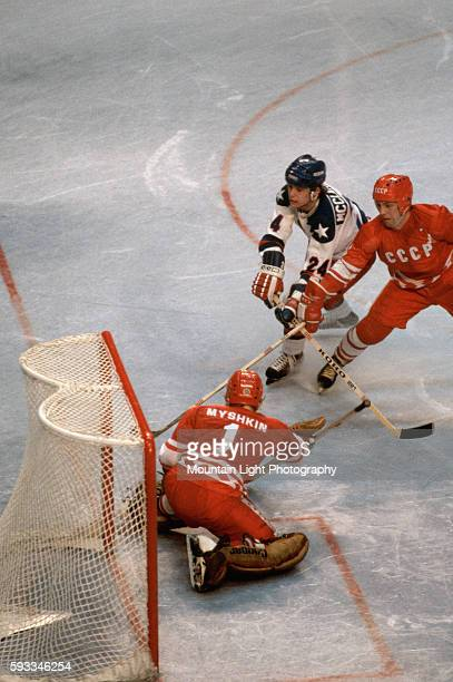 The goalie for the USSR Olympic ice hockey team attempts to stop a puck during a game against the US team at the 1980 Winter Olympics in Lake Placid...