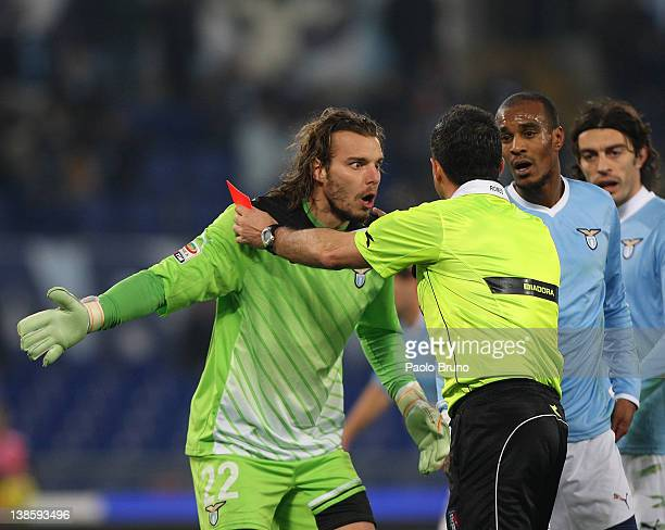 The goalkeeper Federico Marchetti and his teammate Abdoulay Konko of SS lazio protest with the referee Andrea Romeo during the Serie A match between...