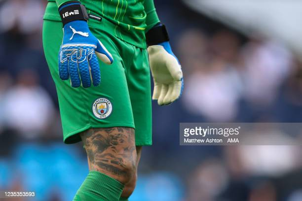 The goalkeeper gloves and leg tattoo of Ederson of Manchester City during the Premier League match between Manchester City and Southampton at Etihad...